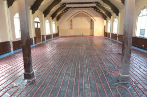 The underfloor heating pipes in place