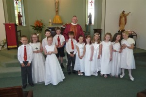 Father Price with our twelve children after their confirmation